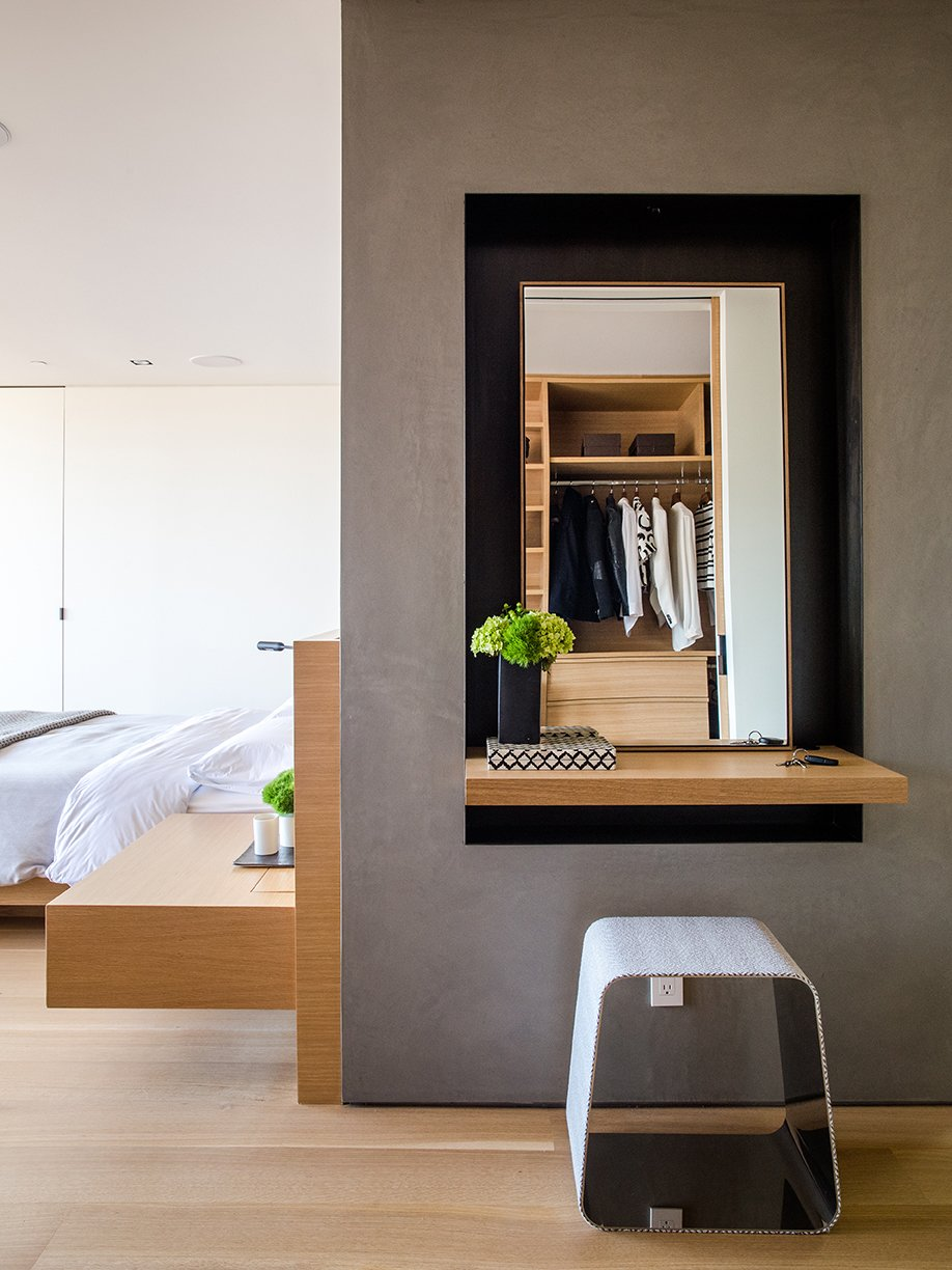 Storage Room and Closet Storage Type Like the bed and built-in nightstand, the door is by Lloyd's Custom Woodwork. The WGS stool near the vanity is by Gallotti&Radice.  Conrad Residence from Domino Effect: How a Bedroom Refresh Jump-Started a Whole-House Remodel For a Tech Exec