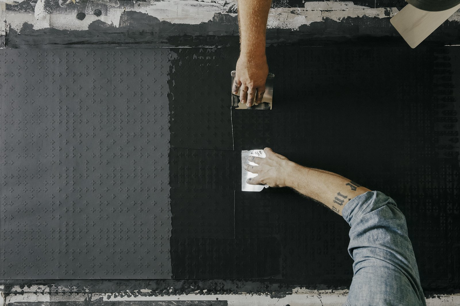 Add topcoat:  A topcoat of marble-dust plaster is applied with  Japanese blades, working horizontally and vertically to create  a grid-like pattern instead of streaky lines.  Photo 11 of 17 in Paper Trail
