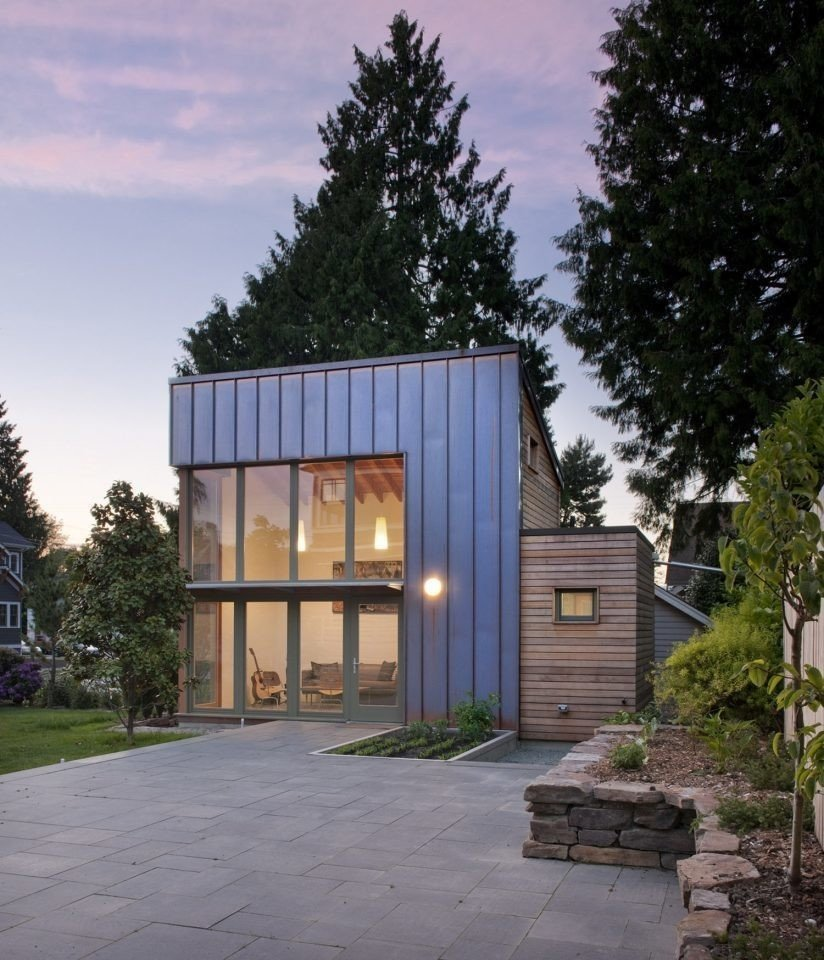 Exterior, Wood, Flat, Metal, and Small Home This Seattle ADU makes a modern statement that's clad in copper and cedar. The backyard  Best Exterior Small Home Metal Wood Photos from 8 Modern In-Law Units