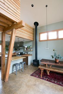 The tall space over the main room features timber detailing and ample natural light from high windows—which also offer privacy from the main house.