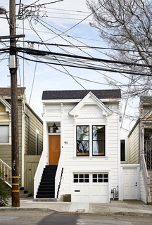 Because of the home's historic designation, the team was limited in what they could change about the facade. They were allowed to repaint it, however, from baby blue to Gray Cloud by Benjamin Moore.