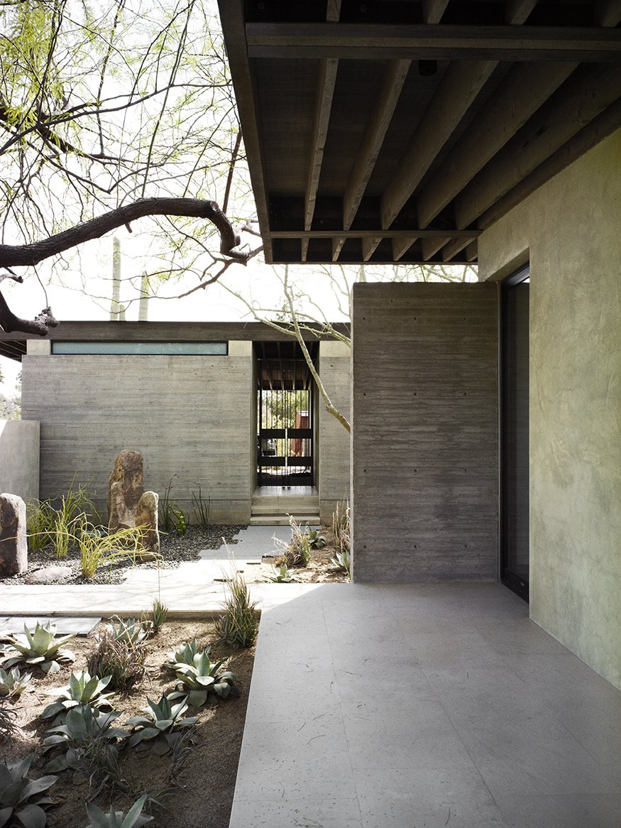 The Phoenix home of designers and builders Sarah Swartz Wessel and Ethan Wessel sits amid desert-friendly trees and plants. The couple bought the property in 1998 and worked on the house for a decade. Tagged: Outdoor.  Wessel Residence