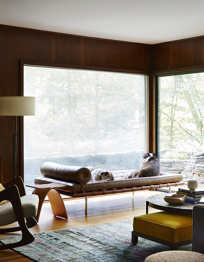 Living Room, Floor Lighting, Lamps, Chair, End Tables, Bench, Ottomans, Coffee Tables, and Light Hardwood Floor Bulldogs Sasha and Sophie rest on a Mies van der Rohe daybed in the lower den. The Capelli stool by Carol Catalano and the rocker by Adrian Pearsall are reserved for their owners.  Best Photos