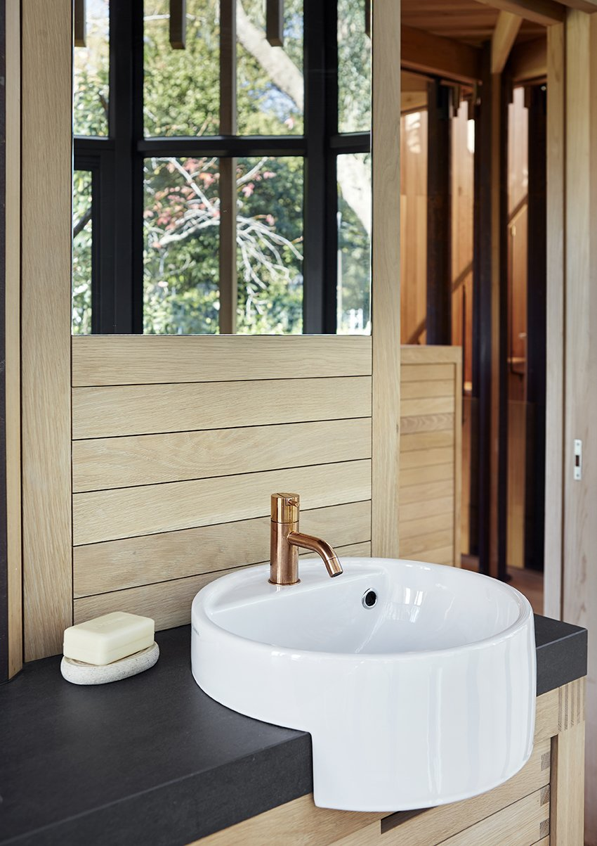 Bath Room and Vessel Sink The bathroom tap is by Vola and the sink is by Ceramica Flaminia.  Photo 5 of 9 in A Floating South African Cabin Borrows From the Landscape