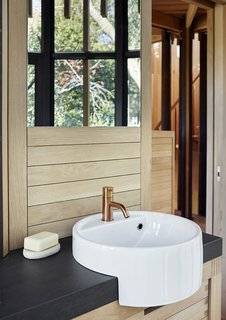 The bathroom tap is by Vola and the sink is by Ceramica Flaminia.