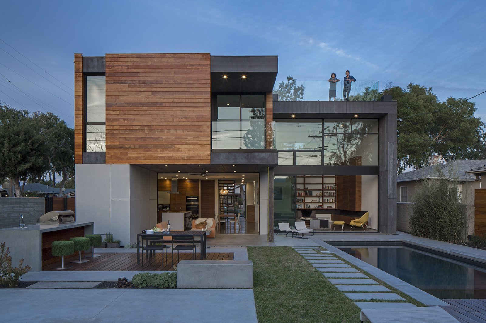 Exterior, House Building Type, Wood Siding Material, and Flat RoofLine Minarc's GRASSsit bar stools, topped with synthetic turf recycled from football fields, sit near the  barbecue.  Walnut House from A Southern Californian Prefab Is Paradise for the Whole Family