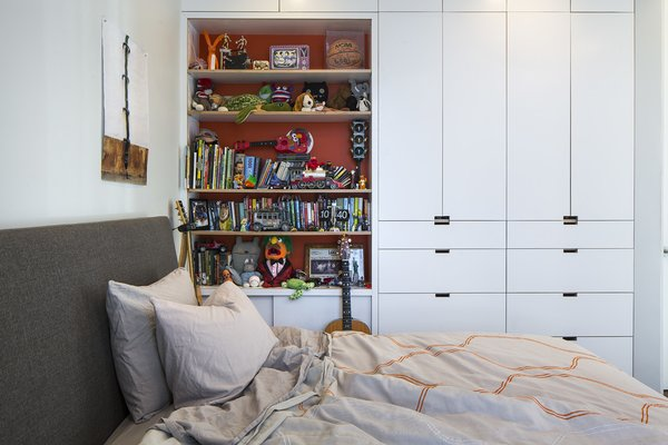 Built-in storage keeps things organized in Leo's bedroom, which contains an Ella bed from Room & Board and an Inmod duvet.