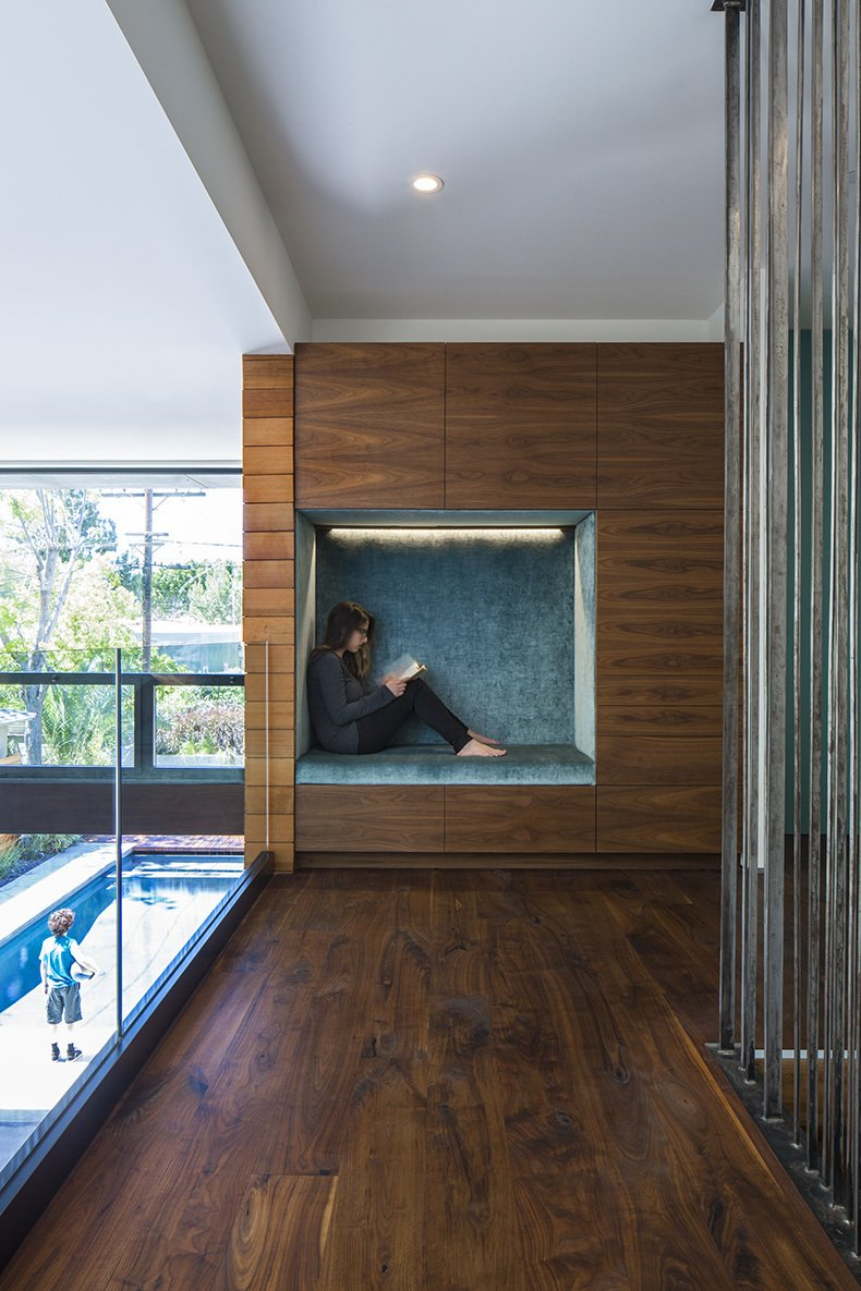 Hallway and Medium Hardwood Floor The second-floor niche, which is lined in Osborne & Little fabric, offers a quiet getaway.  Photo 10 of 12 in A Southern Californian Prefab Is Paradise For the Whole Family