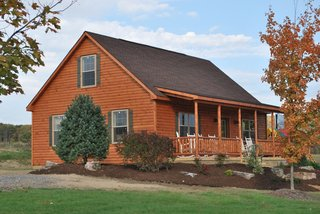 Shawnee Structures offers log homes that feature log siding exteriors with pine interiors and T & G pine floors.