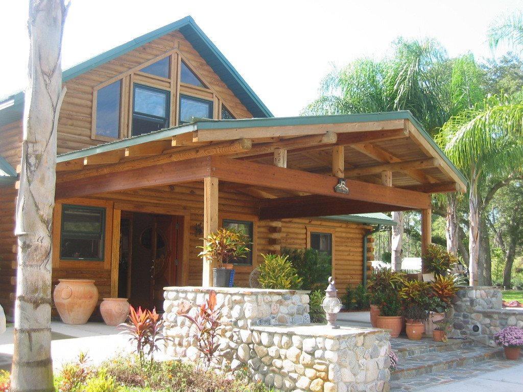 Exterior, Prefab Building Type, House Building Type, Wood Siding Material, and Gable RoofLine Casual Country calls its log package homes  Photo 10 of 11 in 10 Kit Home Companies in the South