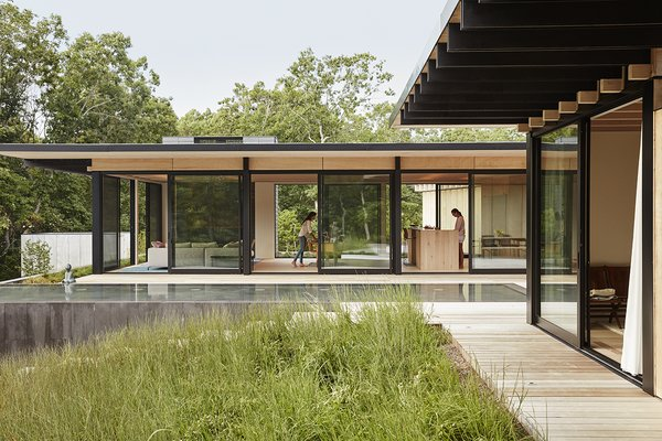 Sliding walls of glass by Arcadia are situated throughout.
