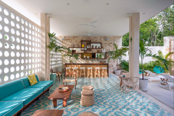 Explore a new, stylish, and surprisingly affordable boutique hotel in Tulum, Mexico, that offers midcentury Miami vibes in the middle of the jungle. Once a quiet little Mexican fishing village, the town of Tulum in the state of Quintana Roo has evolved into a laid-back beach destination that has become the topic of many travel conversations. Located just one-and-a-half hours by car from Cancun International Airport, Tulum sees loads of visitors each year who come to enjoy its sunshine and sandy beaches.