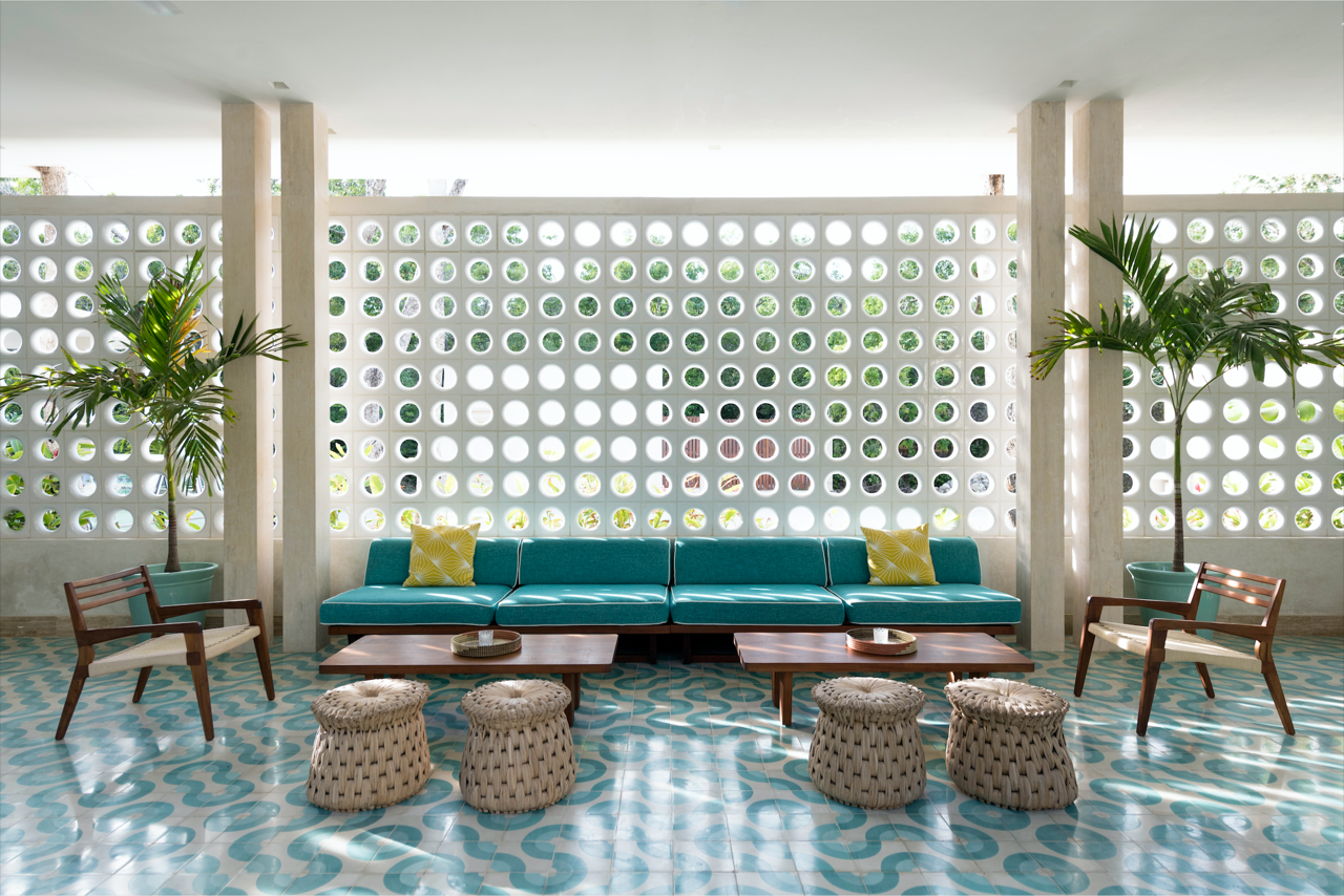 """Living Room, Chair, Bench, Coffee Tables, and Ceramic Tile Floor """"I love the art deco architecture of Miami Beach and all the midcentury buildings. We're not that far away from Miami, so I thought if that architecture works very well over there and we have the exact same climate, why not bring that kind of architecture and revive it in Tulum,"""" says Haag, who kept design-savvy travelers in mind while developing the hotel.   Photo 7 of 9 in A New Modern Hotel Brings Midcentury Miami to Tulum, Mexico"""