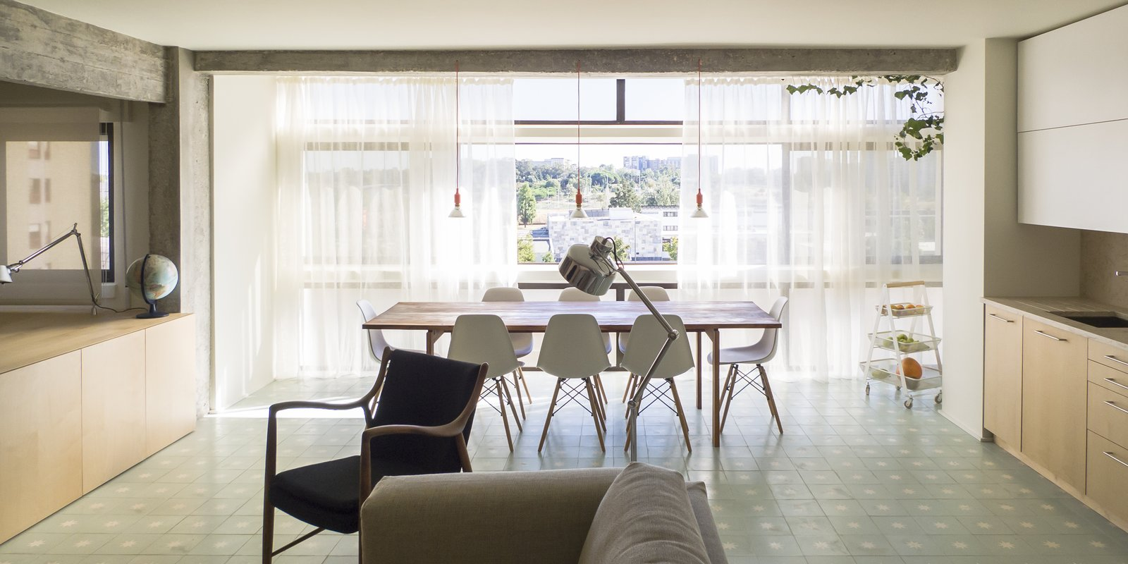 Dining Room, Chair, Table, Ceramic Tile Floor, and Ceiling Lighting - Lisbon, Portugal Dwell Magazine : July / August 2017  The Henriques/Moreira Residence from Lisbon Vision