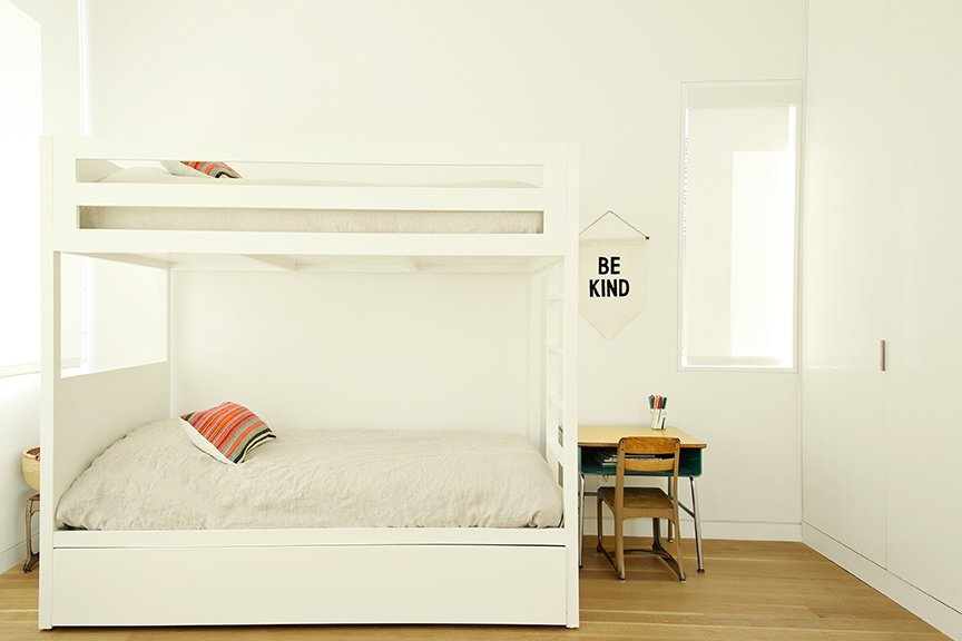 Kids Room, Bedroom Room Type, Medium Hardwood Floor, Bed, Pre-Teen Age, and Neutral Gender Lucas and Noah's bedroom holds a set of bunk beds by Urbangreen.  The Ro Residence from Two Grad-School Friends Apply Their Know-How to a Manhattan Beach Bungalow
