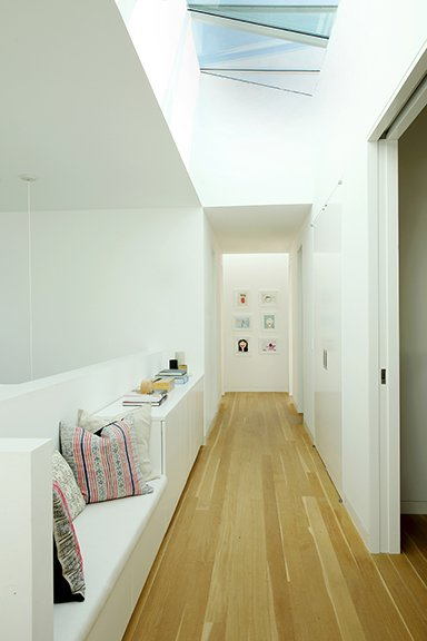 Hallway and Medium Hardwood Floor Large skylights provide an abundance of natural light. The operable skylights are by Industrial Skylights.  The Ro Residence from Two Grad-School Friends Apply Their Know-How to a Manhattan Beach Bungalow