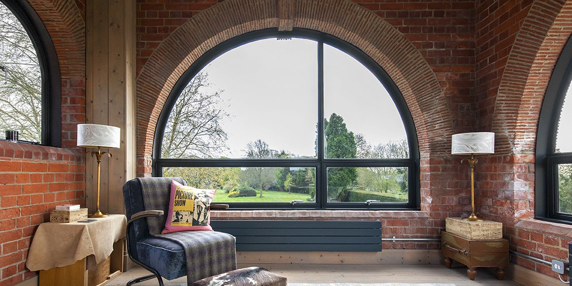 Living Room, Chair, End Tables, Light Hardwood Floor, Table Lighting, and Lamps - Fritham, England Dwell Magazine : July / August 2017  Lister Tower from A Refurbished, Victorian-Era Brick Tower in Hampshire