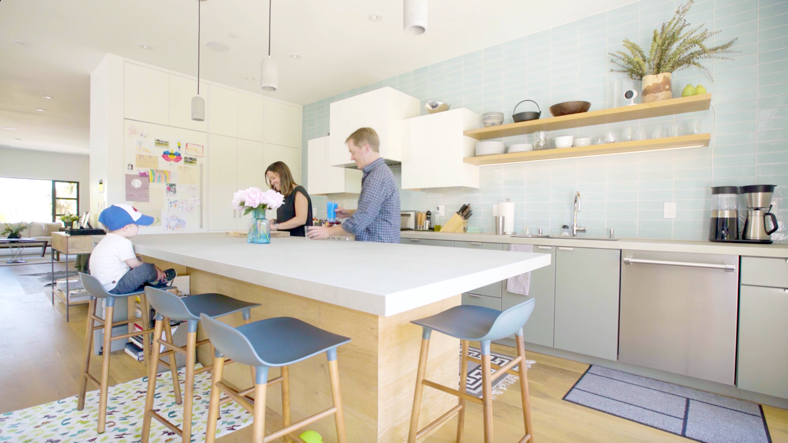 "Kitchen, Pendant Lighting, Colorful Cabinet, and White Cabinet ""Sometimes you catch hilarious moments when you're watching them with Nest Cam IQ,"" says Cameron.*  Best Photos from Revamping the San Francisco Vernacular, Modern Design and Technology Serves A Busy Family"