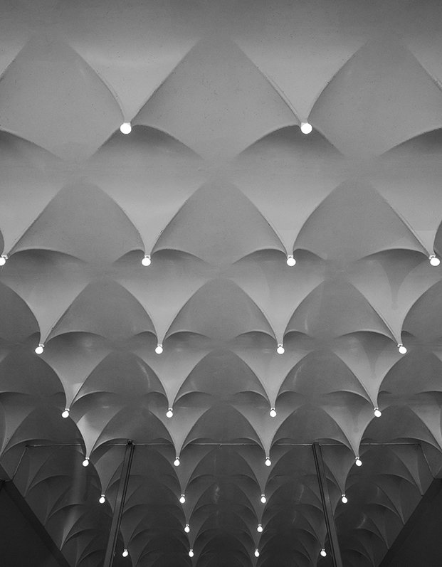 """Office From 1964 to 1965, Alexander Girard designed the interiors of the Cummins Corporate Office. For  the lobby's ceiling, Girard worked with Cummins project  manager Harold Hatter to fabricate the plaster-coated metal """"stalactites."""" - Columbus, Indiana Dwell Magazine : July / August 2017  Photo 12 of 19 in Ode to a Forward-Thinking America: Columbus, Indiana"""