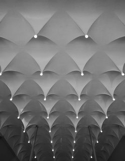 """From 1964 to 1965, Alexander Girard designed the interiors of the Cummins Corporate Office. For  the lobby's ceiling, Girard worked with Cummins project  manager Harold Hatter to fabricate the plaster-coated metal """"stalactites."""" - Columbus, Indiana Dwell Magazine : July / August 2017"""
