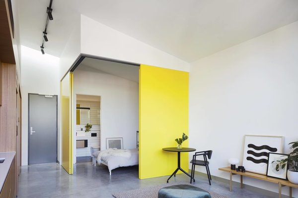 Inside Coppin Street Apartments, MUSK Architecture Studio used flexible floor plans with large sliding doors to demarcate living and sleeping zones.