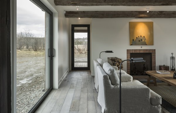 """""""We were researching places where we could get fake old beams, but at the last minute, the contractor found some from a barn that was coming down, - North Hatley, Quebec Dwell Magazine : July / August 2017"""