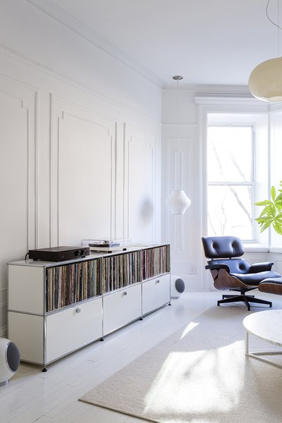 To make the interior of their 12-foot-wide Brooklyn home feel larger, designers Ed Parker and Barbara Tutino Parker used Farrow & Ball paint in All White for the floors and applied Benjamin Moore Super White with a flat finish to the walls. They also rearranged the floor plan. - Brooklyn, New York Dwell Magazine : July / August 2017