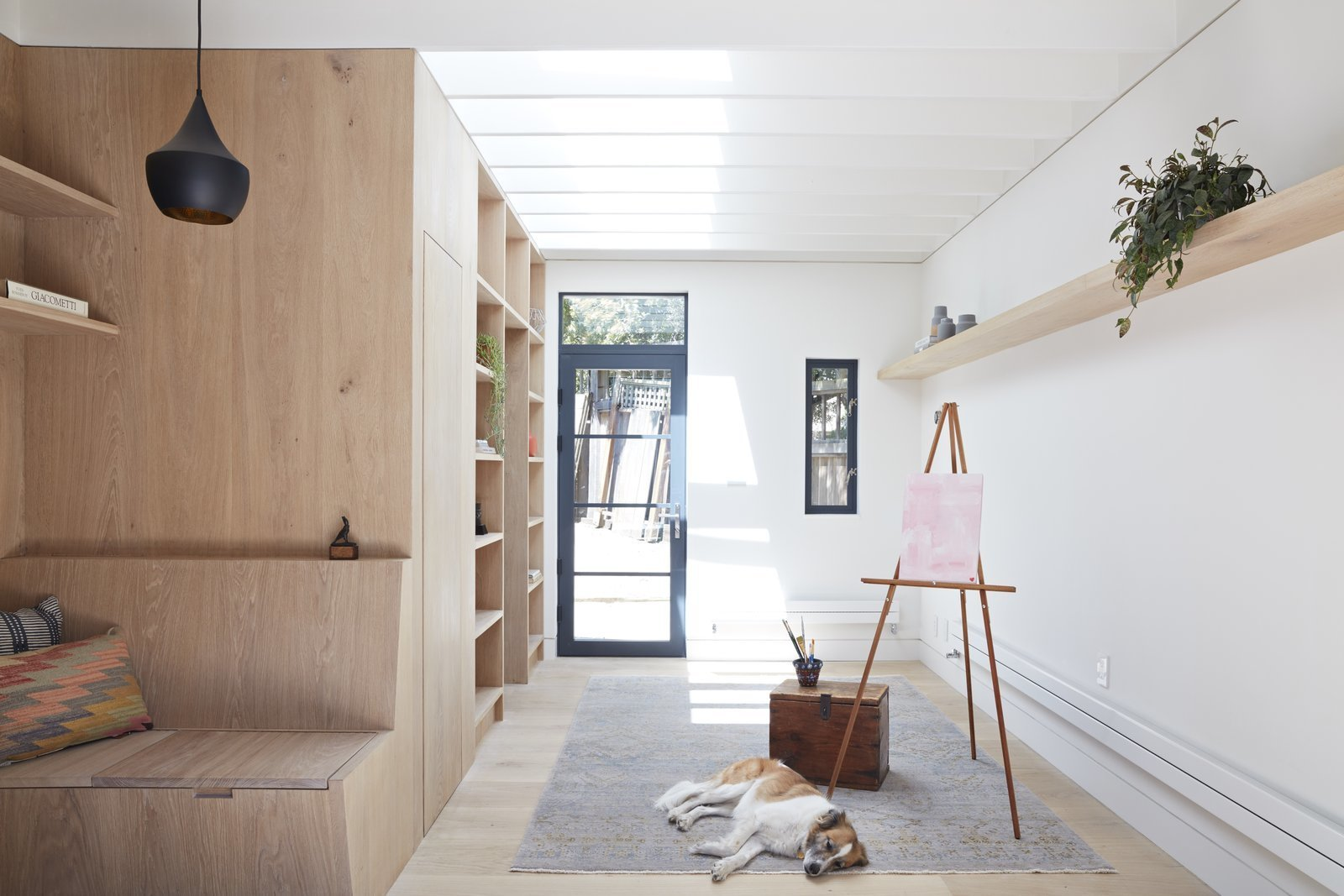 Shed & Studio, Storage Space, Living Room, and Living Space When San Francisco-based architect Beverly Choe took on the project of re-envisioning an old garage (once used as a carriage house that had become a dark and empty space), she sought to create an open and meditative backyard studio where a family can easily retreat to work, relax, and create—with a goal of making it a  Shed & Studio Living Room Photos from An Unused Garage Is Transformed Into a Light-Filled Backyard Studio