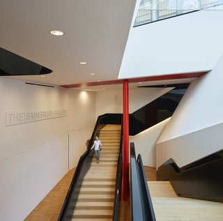 A dramatic staircase leads to the underground gallery space.