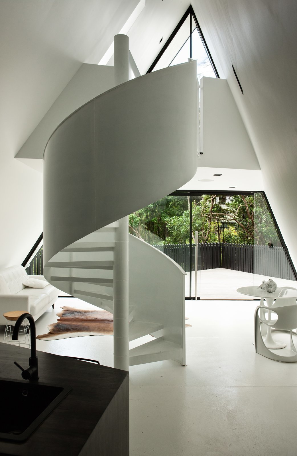 Staircase, Metal Railing, and Metal Tread The sharp ridgeline and soaring soffit reference a tent-like experience in an architecturally elegant way.  Photo 4 of 8 in Stay in a Tent-Inspired A-Frame Cabin in the New Zealand Rain Forest