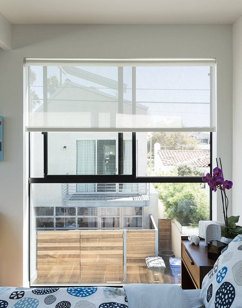 Bedroom and Bed The master bedroom consists  of two modules set above a site-built garage. The fabric is from IKEA. - Santa Monica, California Dwell Magazine : July / August 2017  Hill-Heiserman House