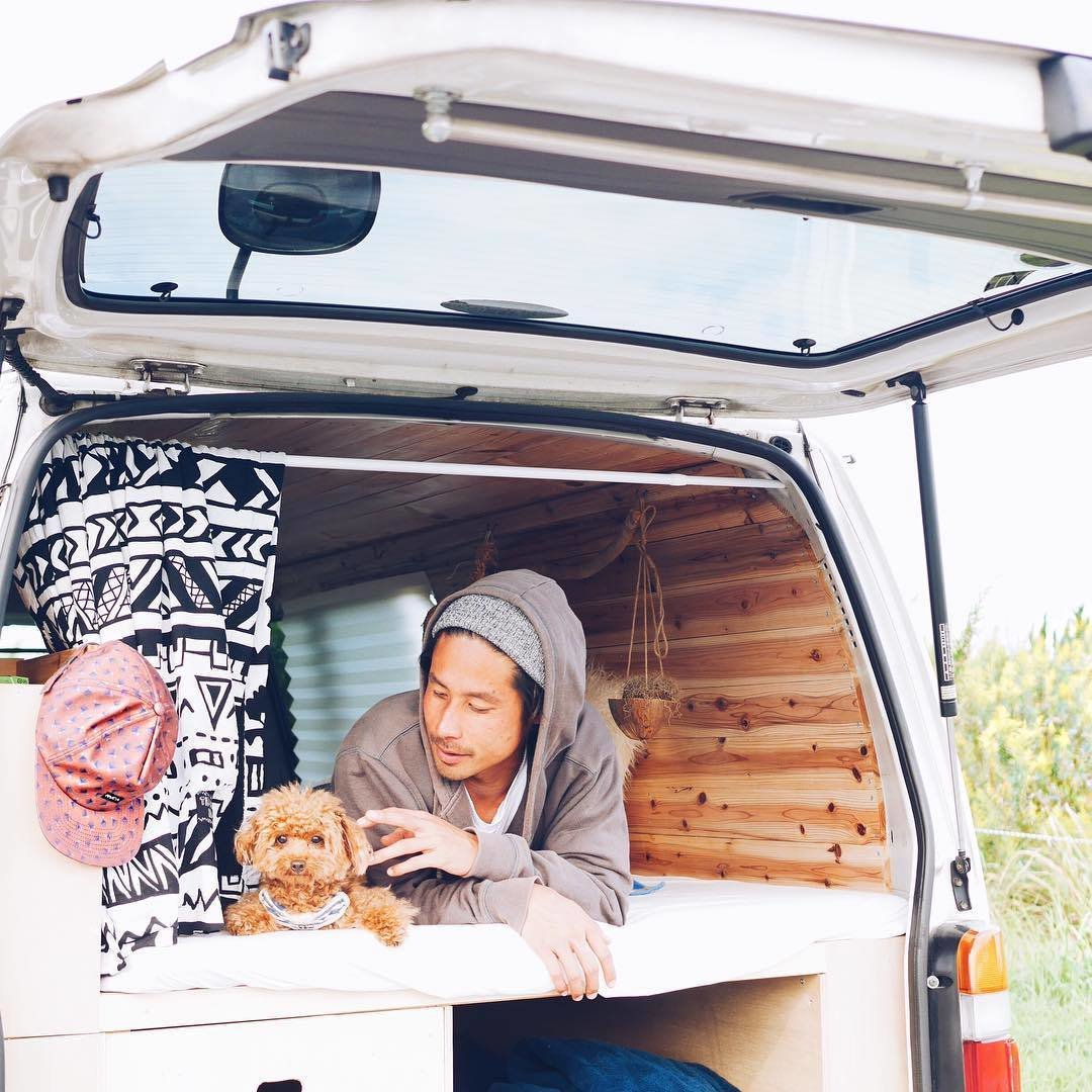A Japanese couple and their fluffy pooch Roy are traversing the heartland of Japan in their stylish, wood-paneled abode.  Photo 3 of 11 in 9 Adventure Seekers Who Celebrate Small Space Living Through the Van Life