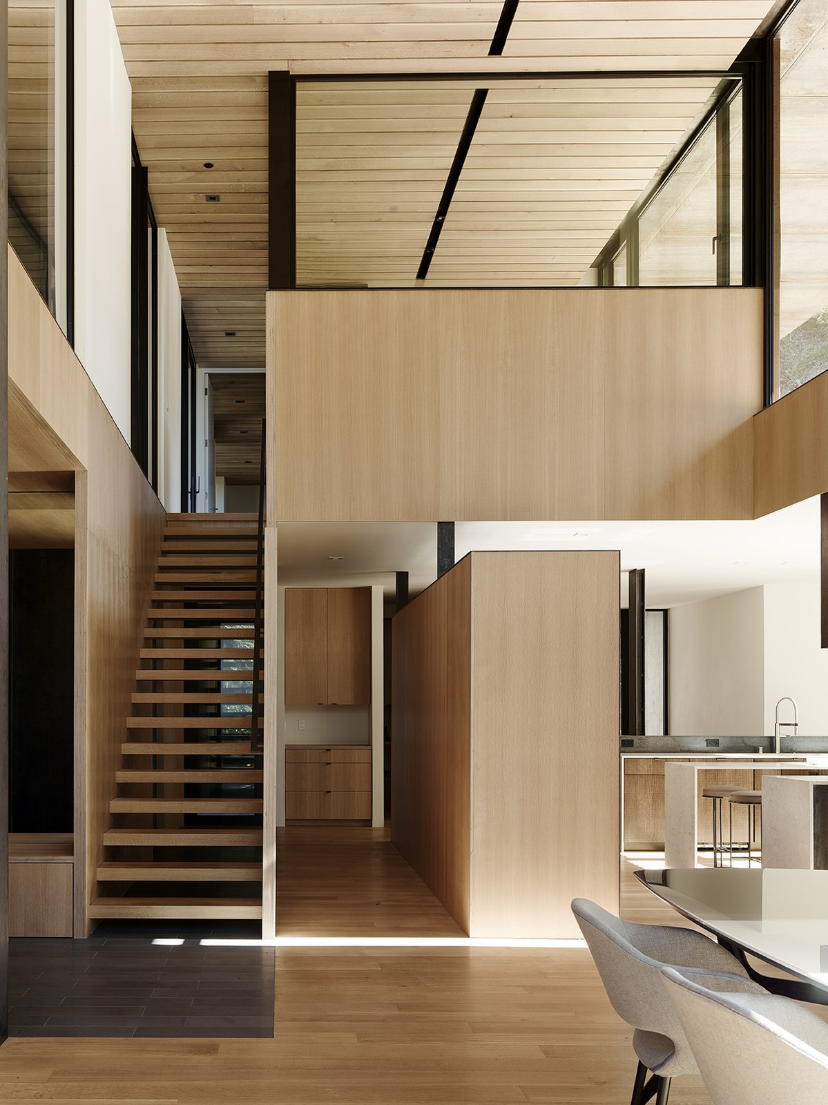 Staircase and Wood Tread The ceiling is untreated white oak.  Photo 6 of 14 in Nature Drove the Design of This Sculptural, Cor-Ten Steel House in Northern California