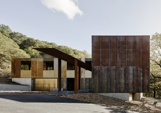 """If ever there was a design for a home that was informed almost exclusively by its setting, it's the one architect Greg Faulkner devised for a wooded site in Northern California. The construction is a rigorously pared-down display of architectural elements that facilitate engagement with the natural environment. """"This was a watershed project for the firm,"""" Faulkner says. """"We were intensely focused on producing a quiet presence. The existing use patterns of the site and the path of the sun and the wind drove the design."""" The property is on an ex-urban infill site located on almost eight acres of a Bay Area suburb. Technically a remodel, the house utilized the footprint of the existing house as a basis for a new floor plan."""