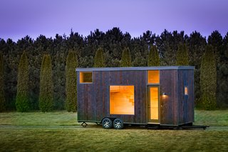 Wisconsin-based ESCAPE, designed the ONE as a transportable tiny home with 276 square feet of adaptable space. The exterior features shou sugi ban siding, and the interior is wrapped in pine. The unit can sleep up to four people, and the pricing begins at just under $50,000.