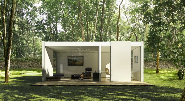 The Backyard Lounge and Office is 330 square feet and features windows on all sides.