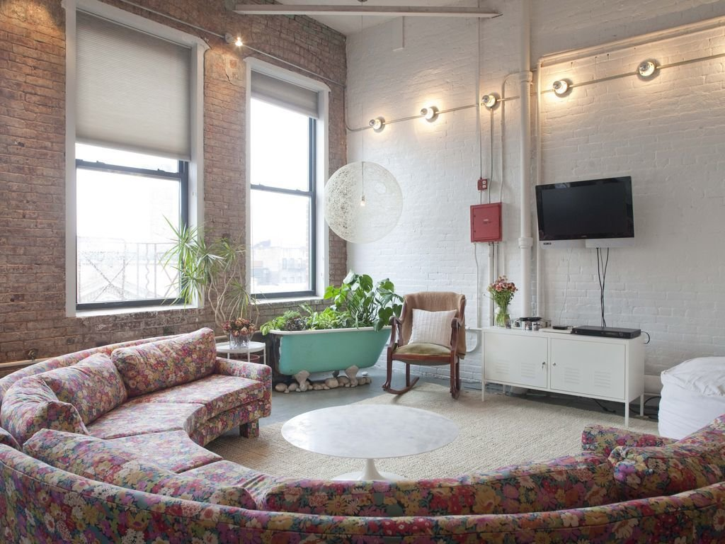 Decorated with a mix of bohemian and mid-century furnishings, this spacious 1,500 square feet loft with high ceilings and exposed brick walls is a cozy refuge in the creative Bowery neighborhood.  Photo 4 of 12 in Experience New York City's Eclectic Side at One of These Modern Short-Term Rentals