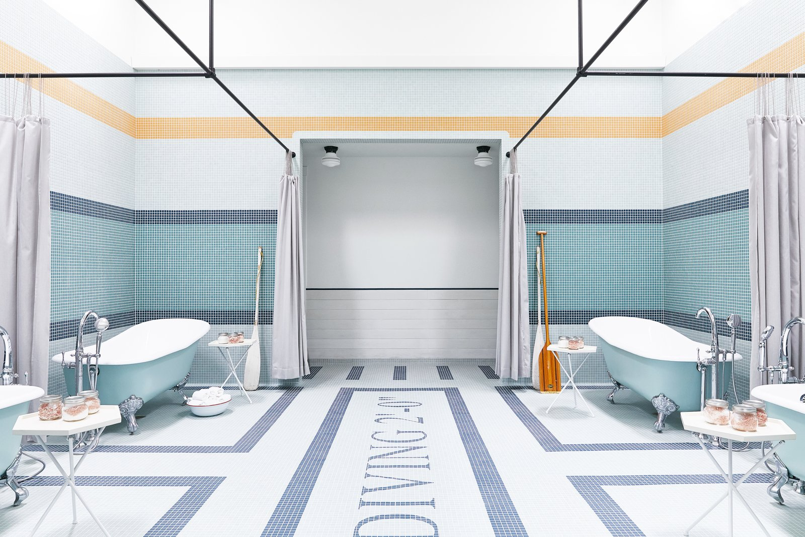 Bath Room, Freestanding Tub, Soaking Tub, Mosaic Tile Wall, and Ceiling Lighting Outfitted with four mint green clawfoot tubs, the bathing room is where guests can steep in medicinal salt soaks.  Photo 9 of 9 in A Napa Valley Motor Lodge Reinterprets the Classic Roadside Motel