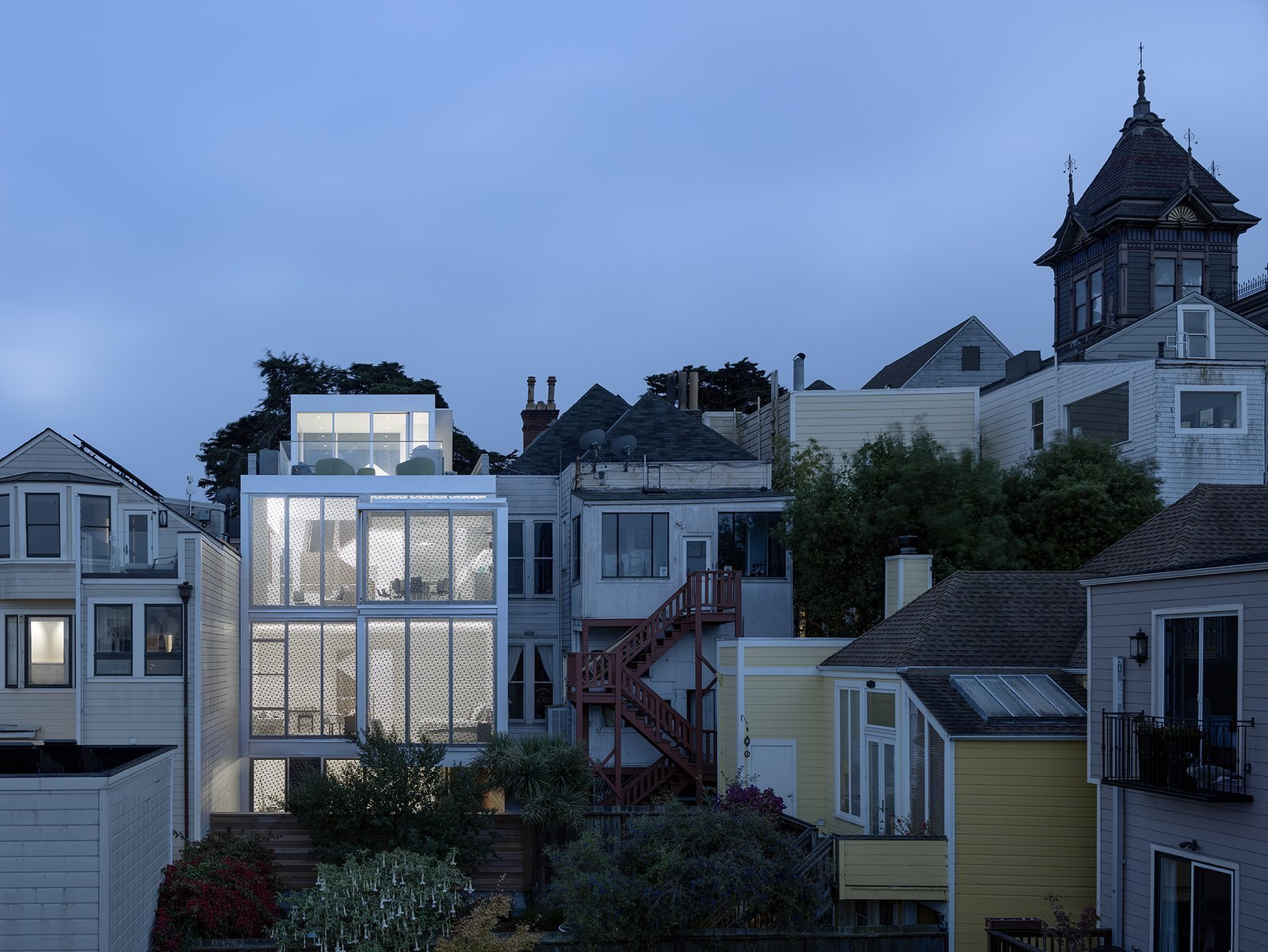 Exterior, House Building Type, and Metal Siding Material The rear façade is illuminated at night.  Best Photos from A Historic Victorian in San Francisco Is Meticulously Transformed Into a Modern Family Home