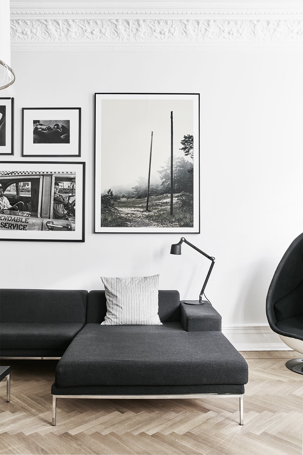 Living Room, Sofa, Sectional, Chair, Lamps, Table Lighting, and Light Hardwood Floor In the living room, a Vipp table lamp rests on a Hockney sofa by Eero Koivisto for David Design. - Gothenburg, Sweden Dwell Magazine : September / October 2017  Photos from A Careful Renovation Brings a 19th-Century Flat in Gothenburg Back to Life