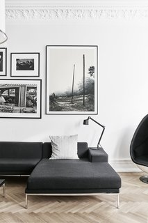 In the living room, a Vipp table lamp rests on a Hockney sofa by Eero Koivisto for David Design. - Gothenburg, Sweden Dwell Magazine : September / October 2017