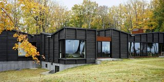 Plagued Ash Trees Were Repurposed to Create This Charred Cedar–Clad Home on Lake Michigan