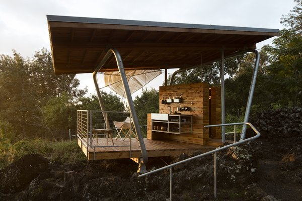 """Makai's structural steel components were designed by Mark Donofrio and affixed to the lava at four points. """"Because of the angle of the lava, it's asymmetrical,"""" says Moore.  Maui, Hawaii Dwell Magazine : September / October 2017"""