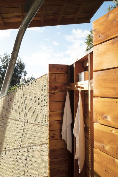 The open-air shower features a screen Moore wove from marine rope.  Maui, Hawaii Dwell Magazine : September / October 2017