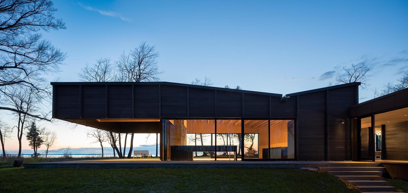 The two sleeping quarters benefit from more solid facade than glass to provide adequate privacy.  Photo 5 of 12 in A Dramatic Cantilevered Roof Creates a Spacious Terrace Overlooking Lake Michigan