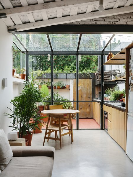 A steel and glass structure wraps one end of the apartment, adding the illusion of greater space to the 720-square-foot home. - Buenos Aires, Argentina Dwell Magazine : September / October 2017