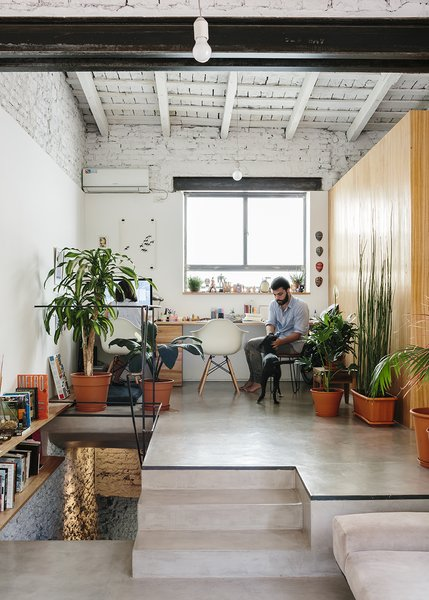 Architect Hernán Landolfo and his girlfriend, photographer Lucia Gentile, live and work in the apartment, sharing an elevated office space. - Buenos Aires, Argentina Dwell Magazine : September / October 2017
