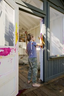 Leo repaints his playhouse in a color that's more to his liking.  Mill Valley, California Dwell Magazine : September / October 2017