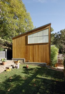 """The home's cedar siding is untreated, and its zinc  roof will """"mellow"""" over time, according to architect Peter Pfau.  Mill Valley, California Dwell Magazine : September / October 2017"""