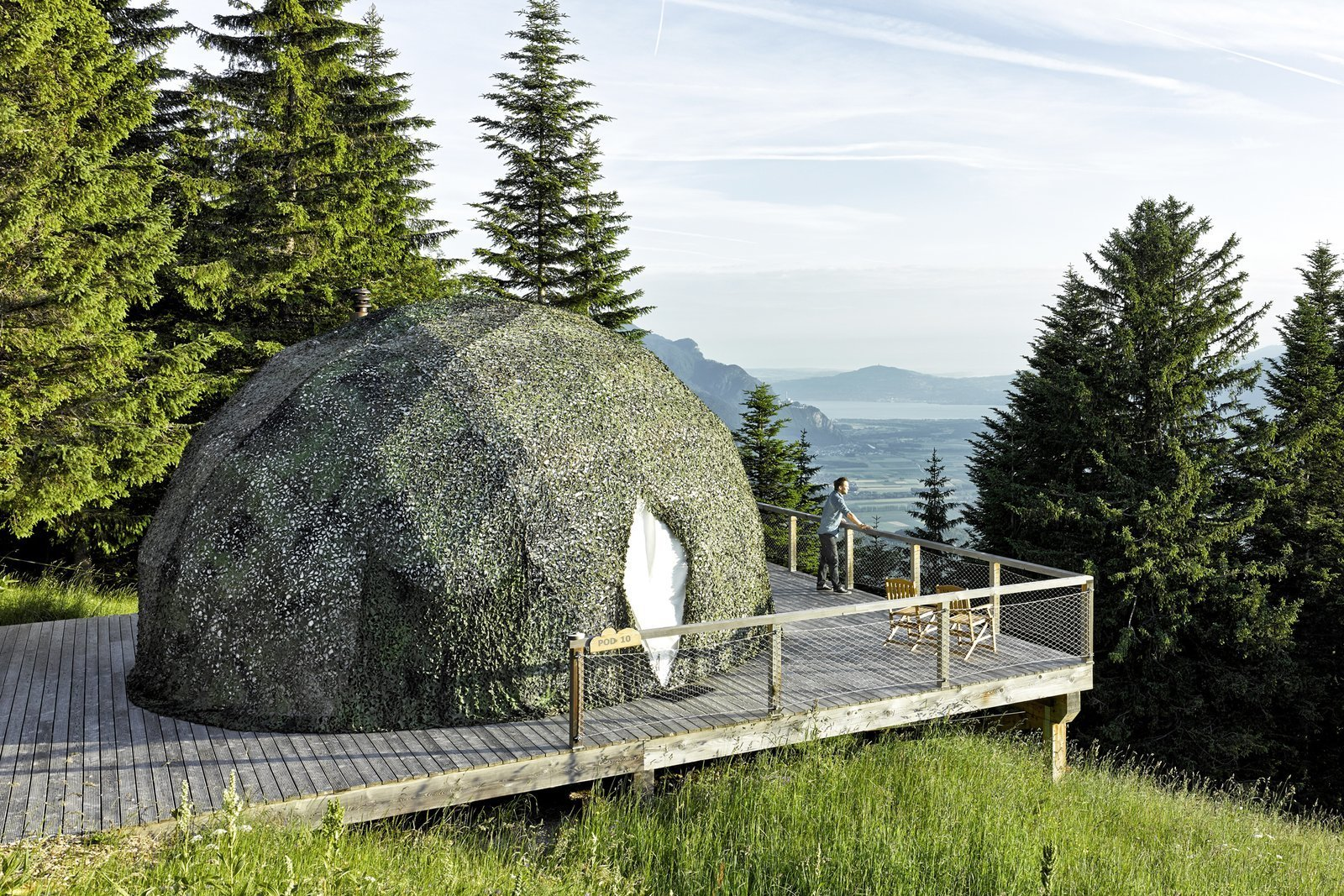 Exterior, Cabin, Prefab, Dome, Glass, and Tent The color of the pods is adapted to each season: white in winter, green in summer.  Best Exterior Prefab Glass Dome Photos from Go Eco-Friendly Glamping in These Geodesic Domes in the Swiss Alps